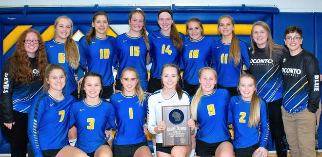 Oconto volleyball team members pose with their regional championship plaque on Saturday night: From left, front: Maggie Sohrweide, Hallie Wusterbarth, Leah Allan, Aubree Bucheger, Emma Walkowiak, Maycie Phillips; back row,  manager Mallory Allen, Baleigh Gering, Hannah Moe, Cora Behnke, Mara Allen, Hailie McDonell, Jenna Hornblad, manager Molly Boucher, manager Jack Savin