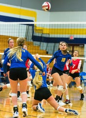 Oconto's Baleigh Gering digs a ball and keeps it in play during the second set against Pacelli Catholic in the regional final Saturday night in Oconto.