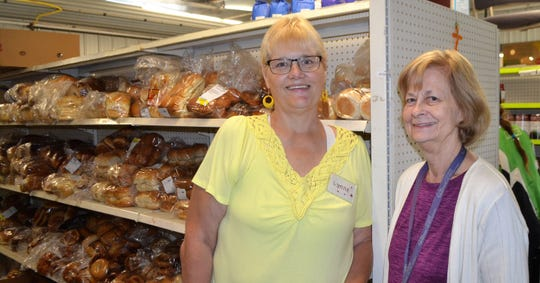 Lynne McFadden of Oconto and Karen Lutz of Oconto Falls are two of the five volunteer co-managers at Kingdom Come Food Pantry in Oconto Falls.