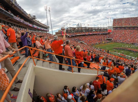 Clemson football fans watch the National Anthem with an airplane fly over before the game in Memorial Stadium on Saturday, October 20, 2018.