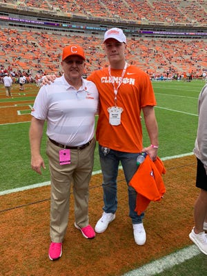 Offensive lineman Walker Parks (right) and Clemson offensive line coach Robbie Caldwell at Saturday's game against N.C. State.