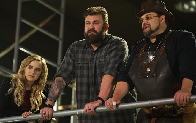 Ashley Hlebinsky, Zeke Stout and Trent Tye observe contestants from a catwalk overhead in the premier episode of 'Master of Arms,' a new Discovery Channel show.