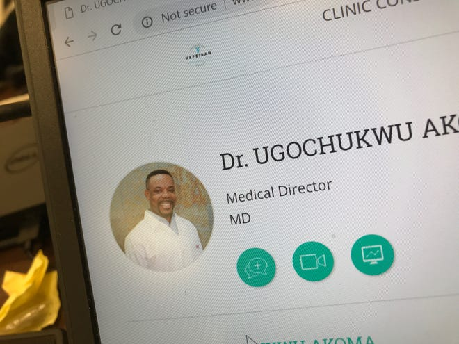 Dr. Ugochukwu Akoma is shown in this photo on his clinic's website.