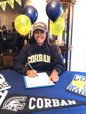 Asia Sage Ramiro Castro Jackson signs a letter of intent to play soccor on an athletic scholarship at Corban University in Oregon on Oct. 7, 2018.