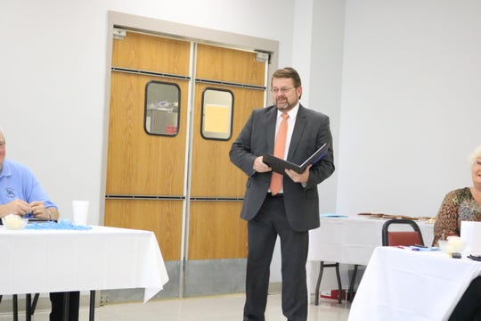 Judge Executive Adam O'Nan reads a proclamation that was accepted during Tuesday's Fiscal Court meeting.