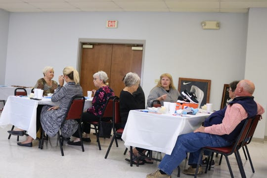Guests enjoy the luncheon.