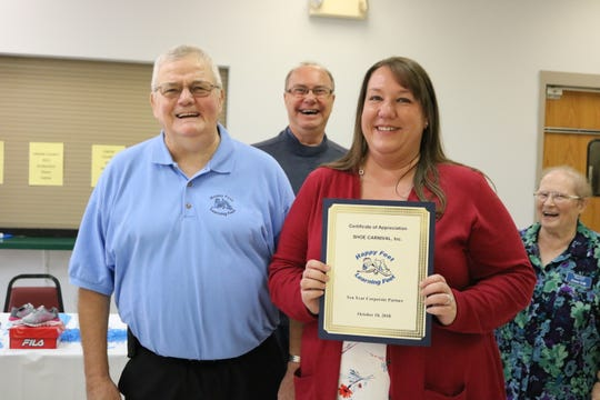 Shoe Carnival's Erica Robb, Store Operations, accepted a 10 Year Business Partner Award from President Jerry Baird.