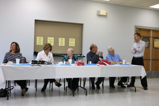 The board members for Happy Feet Equals Learning Feet enjoy their meal during the luncheon.
