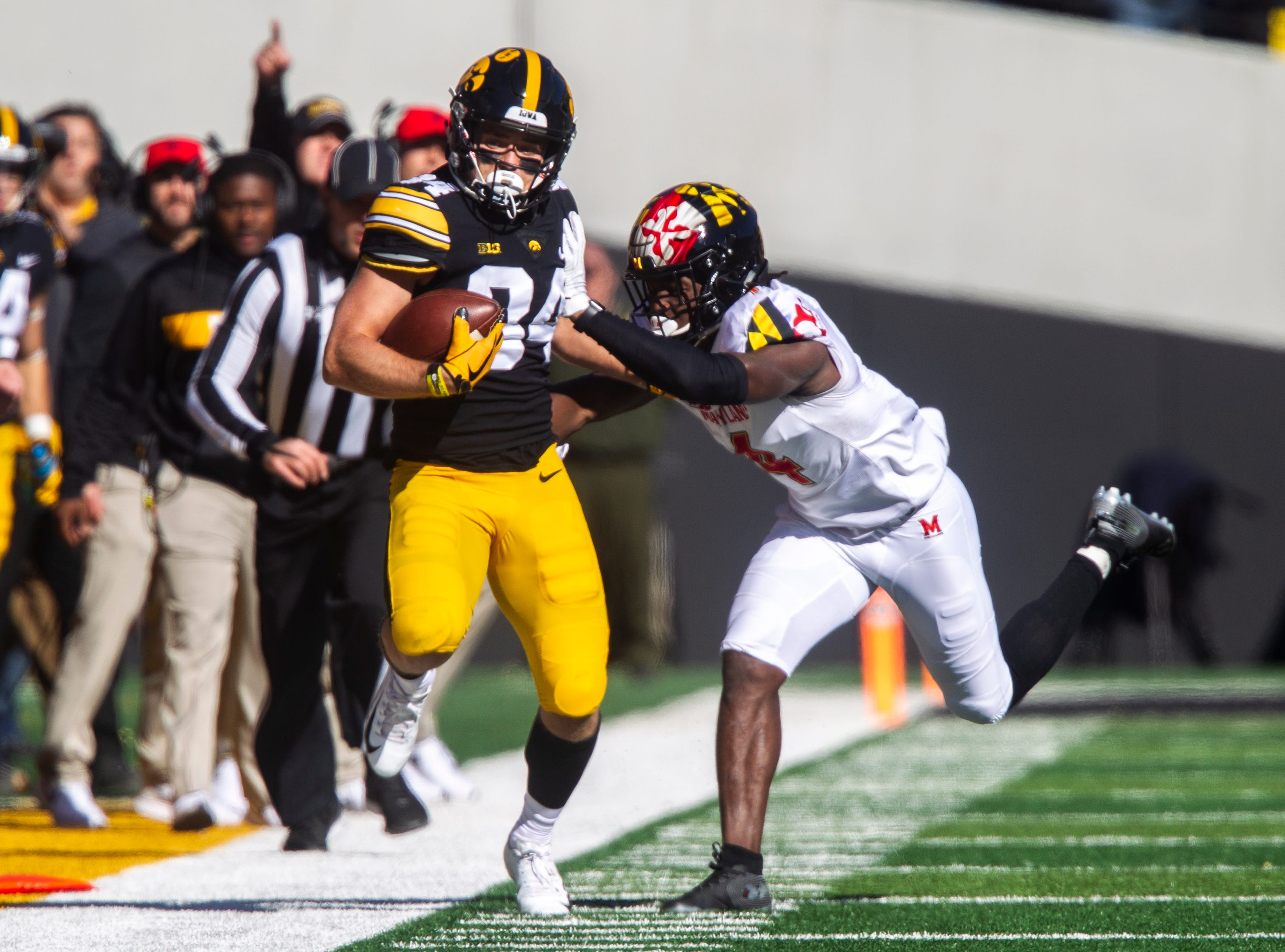 Iowa wide receiver Nick Easley (84) gets pushed out of bounds by Maryland defensive back Darnell Savage, Jr. (4) during an NCAA Big Ten conference football game on Saturday, Oct. 20, 2018, at Kinnick Stadium in Iowa City.