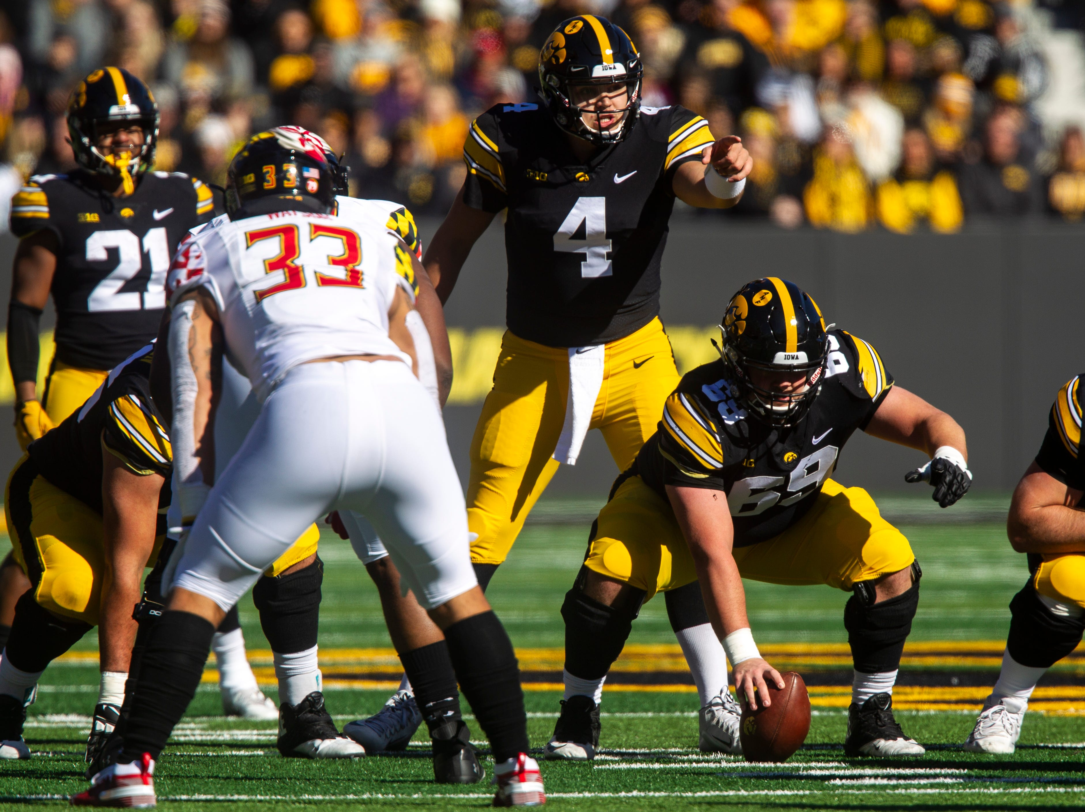 Iowa quarterback Nate Stanley (4) calls out defensive coverage before taking a snap from Iowa center Keegan Render (69) during an NCAA Big Ten conference football game on Saturday, Oct. 20, 2018, at Kinnick Stadium in Iowa City.