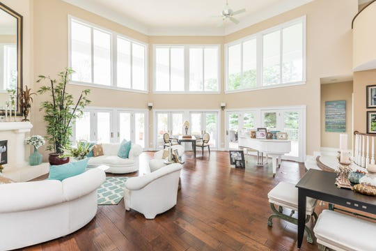 The living room with several large windows and high ceilings has the best views of Geist Reservoir.