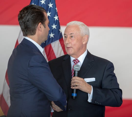 Greg Pence (right), shakes the hand of Donald Trump Jr. who came to lobby for Mike Braun and Pence, who are running for office on Nov. 6, Indianapolis Regional Airport in Greenfield, Monday, Oct. 22, 2018.