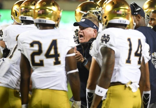BLACKSBURG, VA - OCTOBER 6: Head coach Brian Kelly of the Notre Dame Fighting Irish speak with his team during a timeout in the first half against the Virginia Tech Hokies at Lane Stadium on October 6, 2018 in Blacksburg, Virginia. (Photo by Michael Shroyer/Getty Images)