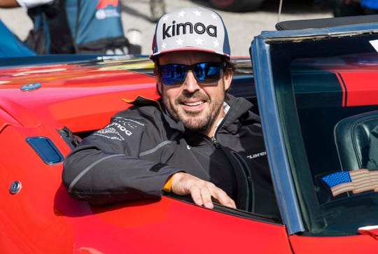 McLaren driver Fernando Alonso (14) of Spain rides in the driver's parade before the United States Grand Prix at Circuit of the Americas.