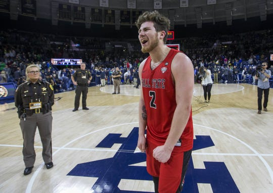 Ball State's Tayler Persons (2) celebrates as he exits the court following the Cardinals' upset win over Notre Dame last season.