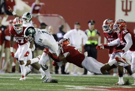 Michigan State quarterback Brian Lewerke (14) is tackled by Indiana's Reakwon Jones (7) during the second half, Sept. 22, 2018, in Bloomington.