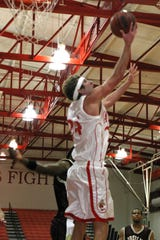 Alex Rinks performs a reverse layup while playing for Wabash College.
