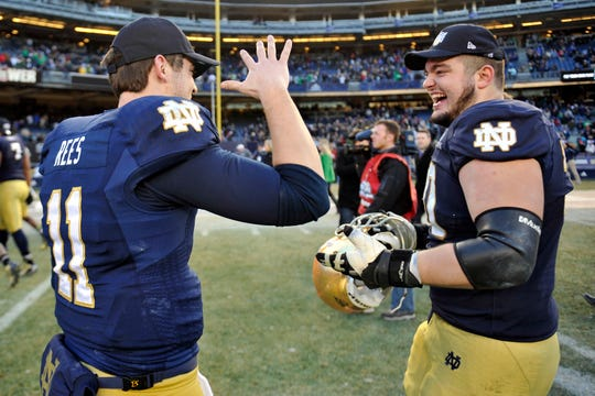 FILE – Former Notre Dame offensive tackle Zack Martin (right) and quarterback Tommy Rees (left) still keep in contact. Rees is now on the Irish staff.