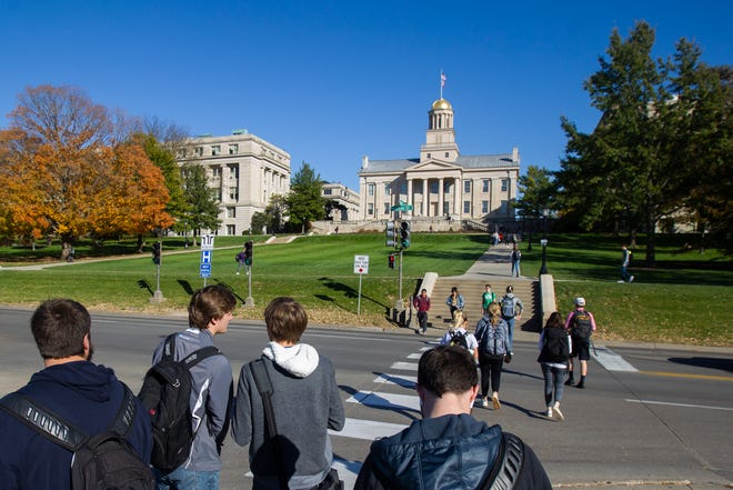 Students wait to cross Madison Street towards the Old Capitol on Monday, Oct. 22, 2018, on the University of Iowa campus in Iowa City.