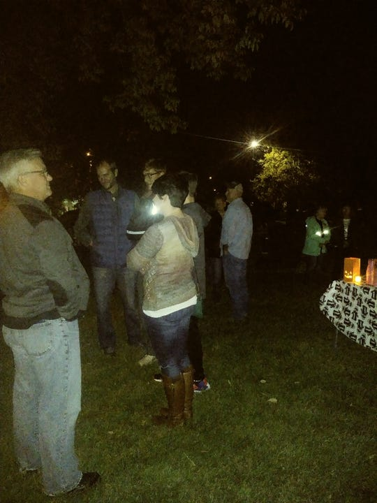 About 40 people arrived outside Linden Hill on Friday night as part of the ghost walking tour in Holly Springs. Not long after, the rain began.