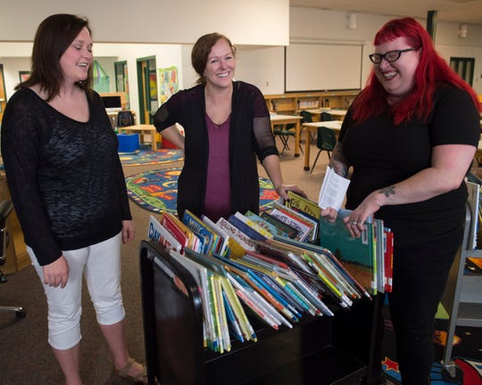 Kaiden Mann was born with Apert Syndrome, which makes him look different than other kids. His mom, Carla Mann, wrote a letter about Kaiden that was passed out to the other parents. Here, Charlene Ross (left) Carla Mann (center) and Kimmie Huff (right) talk about the letter helping them to teach their children to embrace differences. Kaiden is friends with Ross and Huff's children.