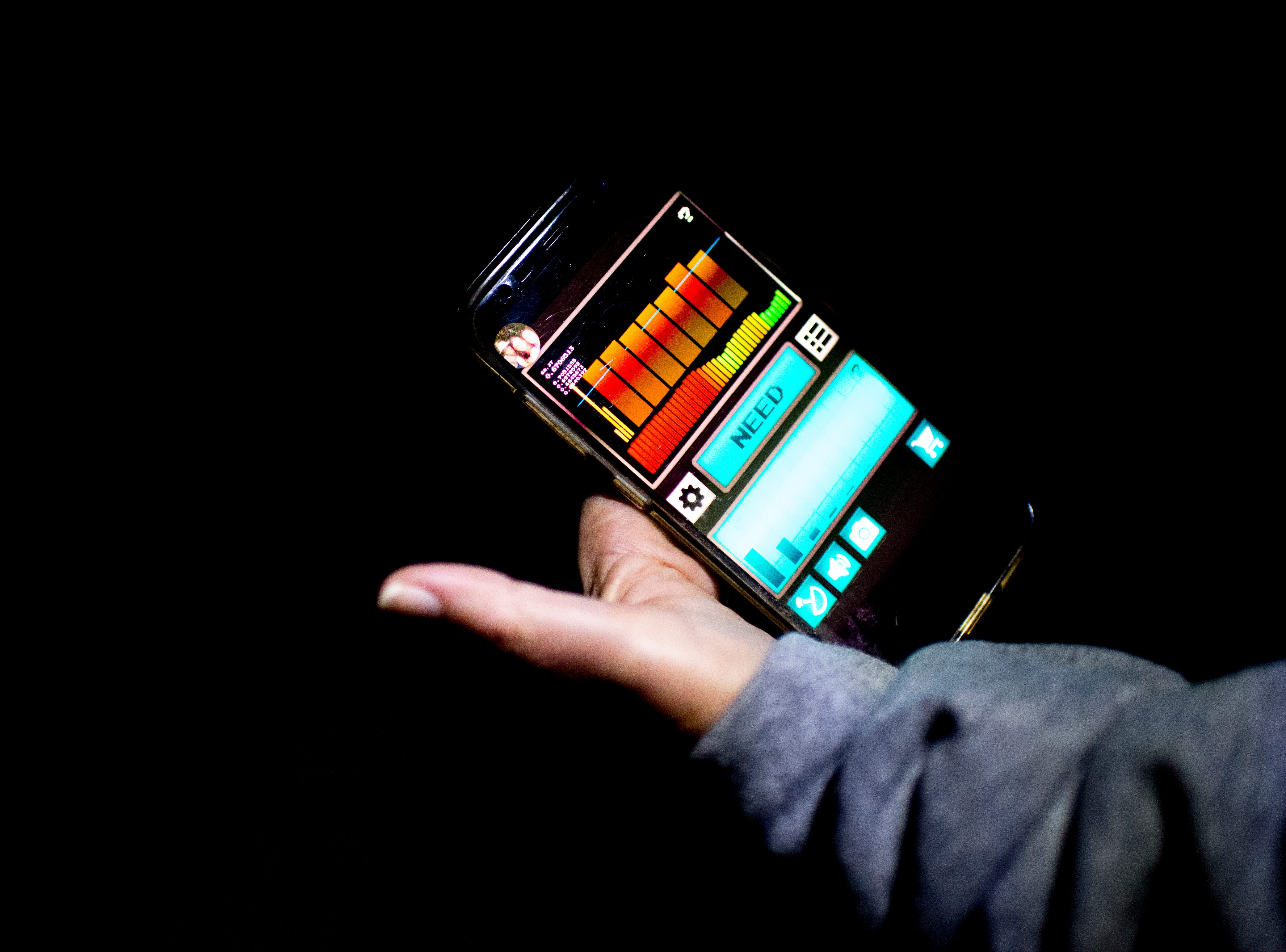 Tour guide Debbie Williams shows her ghost hunting app during a paranormal flashlight tour of Brushy Mountain State Penitentiary in Petros, Tennessee on Tuesday, October 16, 2018.