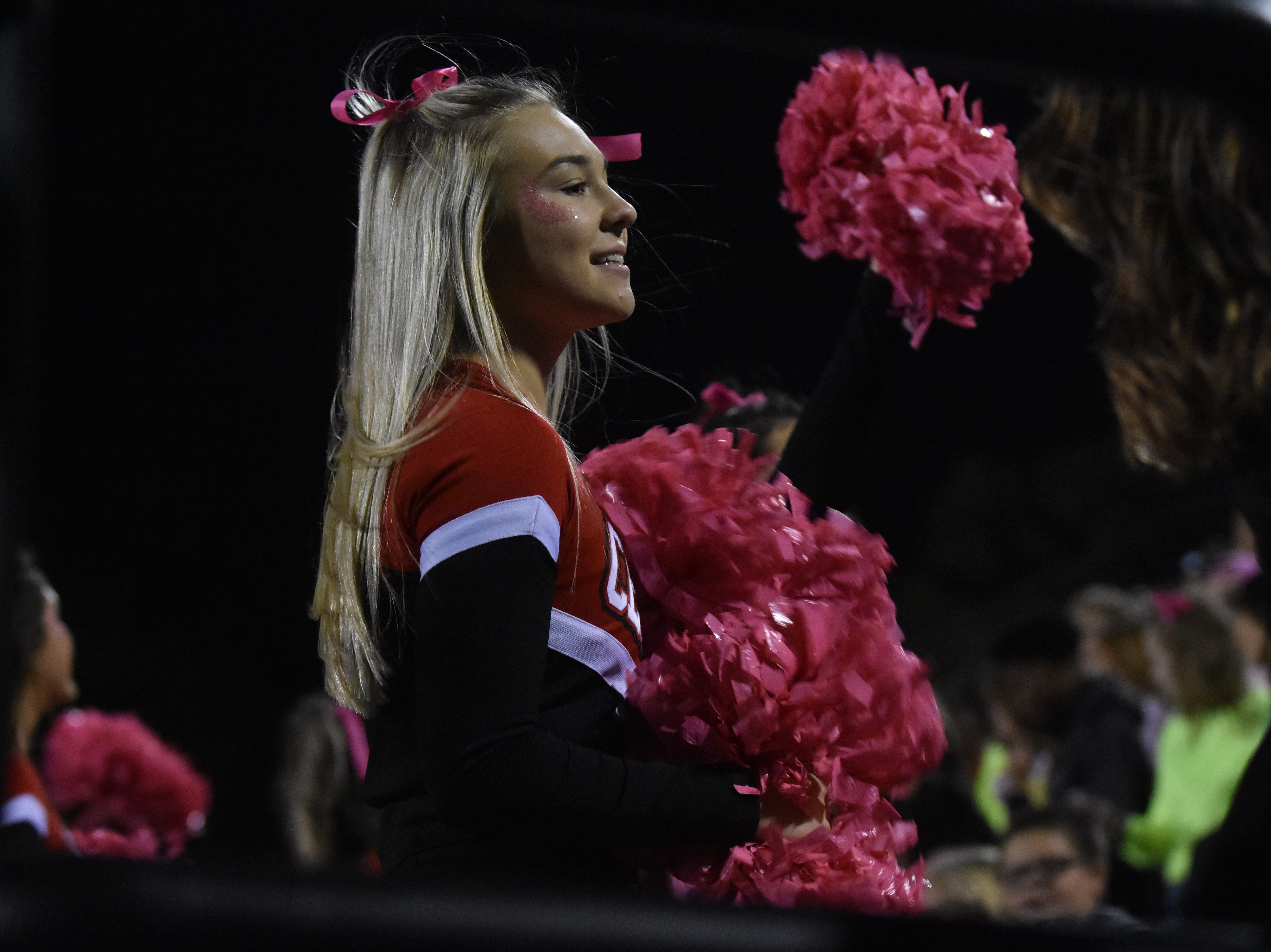A Central High cheerleaders leads the crowd in a chant during the game against South-Doyle on Friday, Oct. 19.