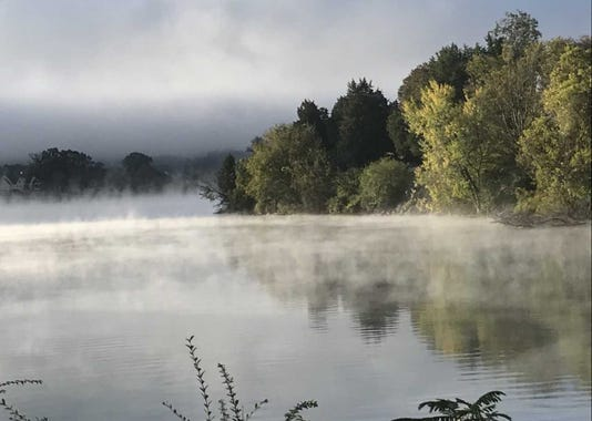 Fog rising over water
