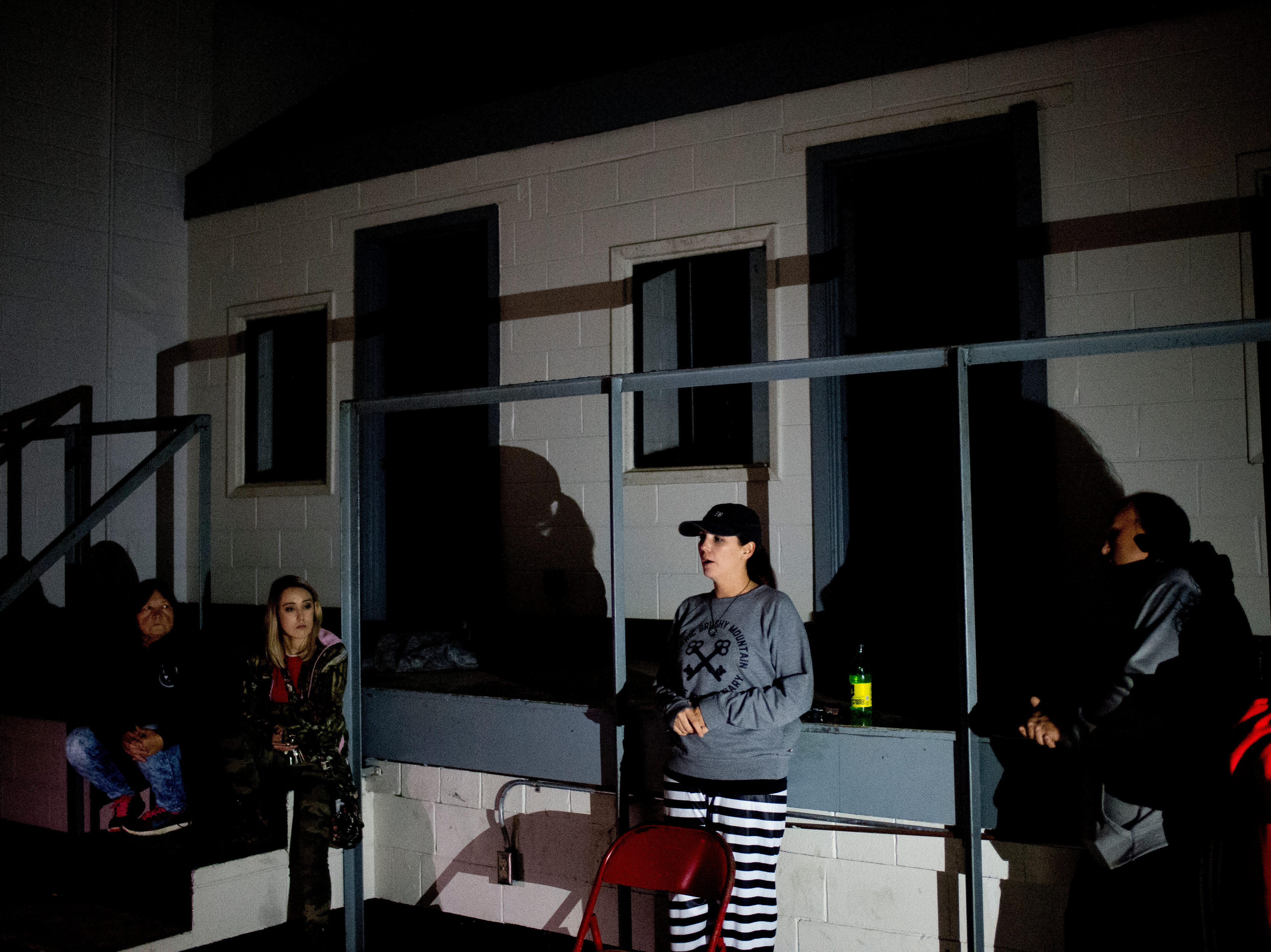 The tour group gathers in the auditorium and hospital during a paranormal flashlight tour of Brushy Mountain State Penitentiary in Petros, Tennessee on Tuesday, October 16, 2018.