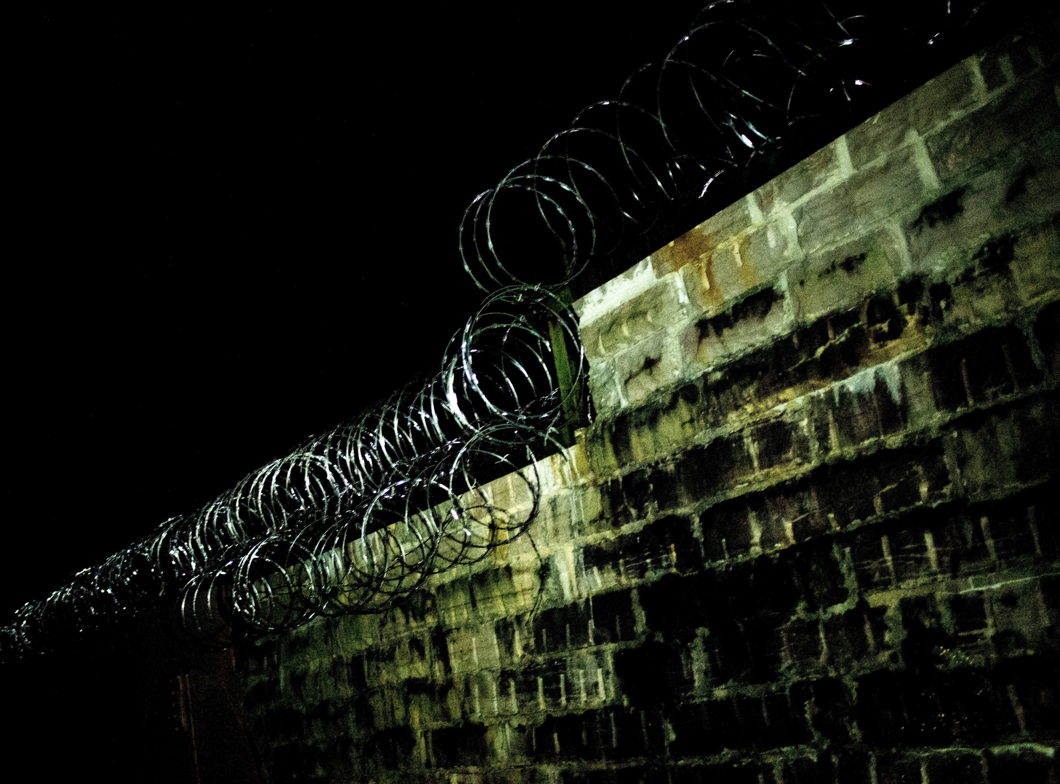 Barbed wire still surrounds the entire property during a paranormal flashlight tour of Brushy Mountain State Penitentiary in Petros, Tennessee on Tuesday, October 16, 2018.