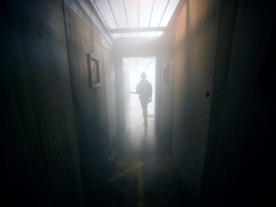 FrightWorks' Dustin Payne leads the News Sentinel down a hallway in the haunted house on Oct. 19.