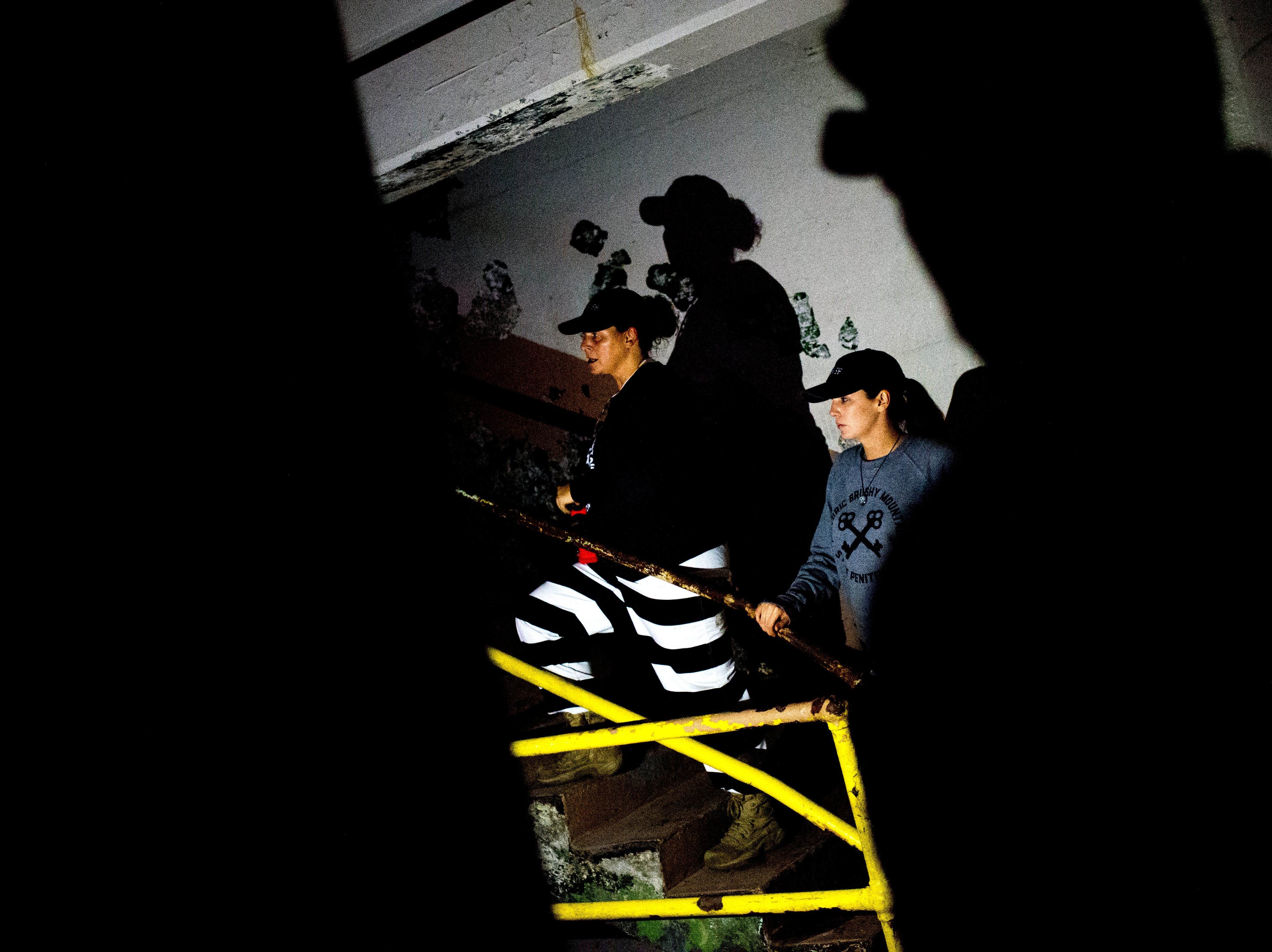 Jaime Brock leads the tour to the next level of a cell block during a paranormal flashlight tour of Brushy Mountain State Penitentiary in Petros, Tennessee on Tuesday, October 16, 2018.