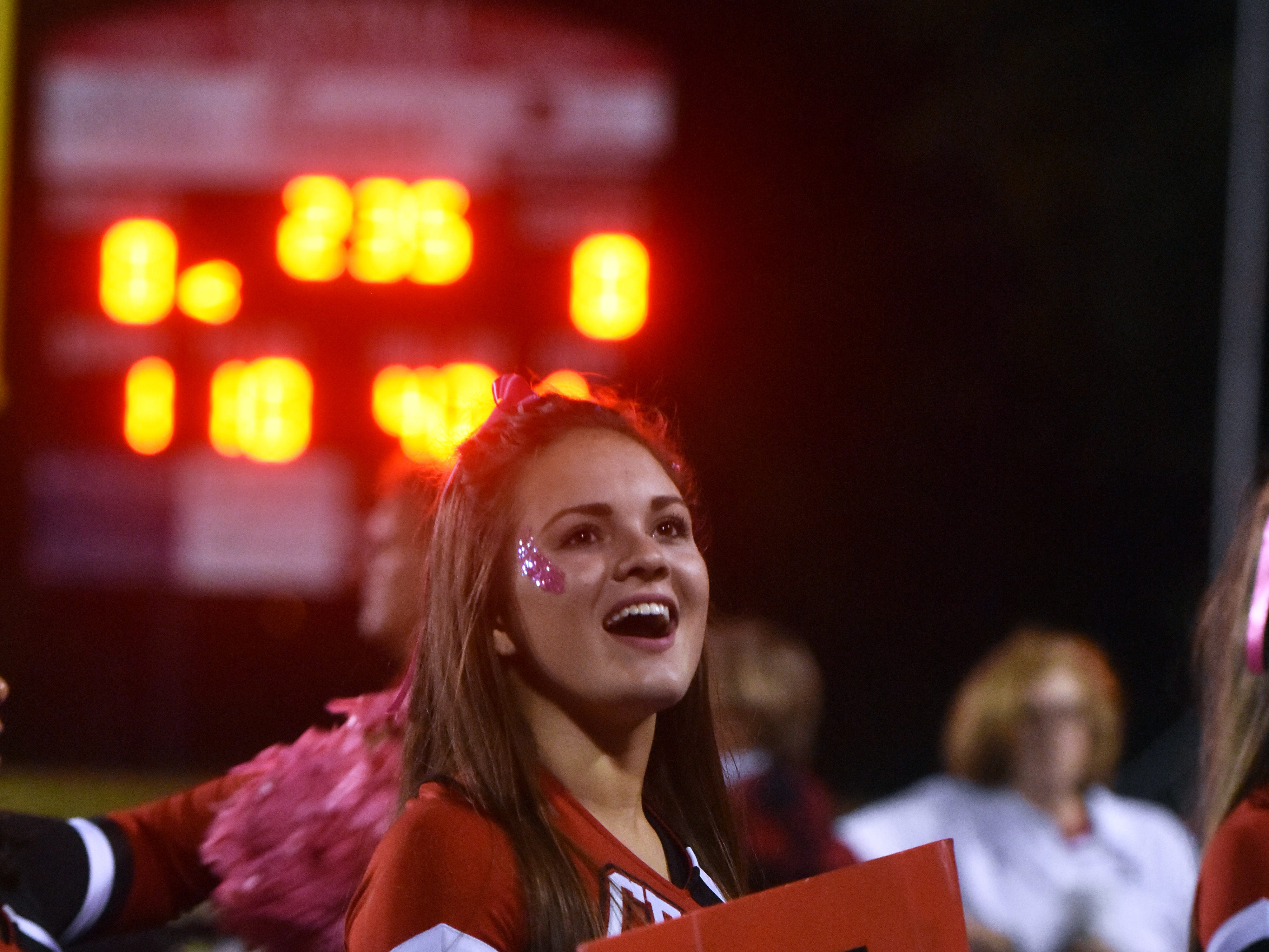 Central High cheerleader Gabby Bratcher leads the student section in a cheer during the game against South-Doyle on Friday, Oct. 19.