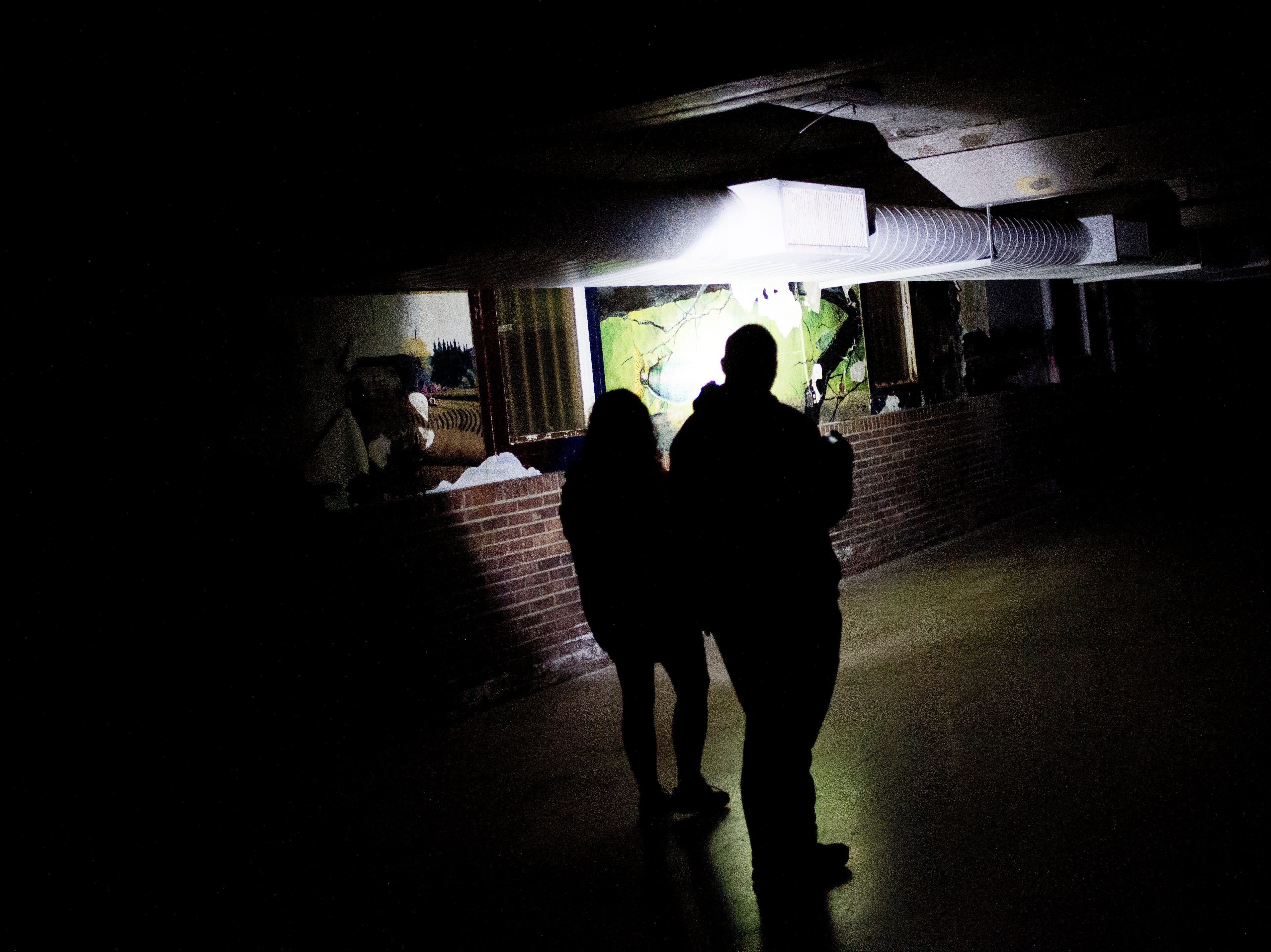 Visitors tour the cafeteria during a paranormal flashlight tour of Brushy Mountain State Penitentiary in Petros, Tennessee on Tuesday, October 16, 2018.