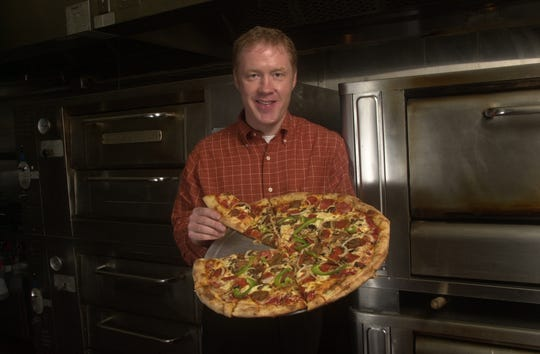 A young Randy Burleson with a pizza hot from the oven at Barley's Taproom and Pizzeria in the Old City, circa 2002.