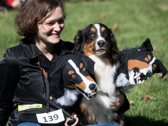 Kami Wilkins and her three-headed Australian shepherd named Jake turned a lot of heads at the Howl-O-Ween Pooch Parade and Pet Expo at the UT Gardens on Oct. 21, 2018.