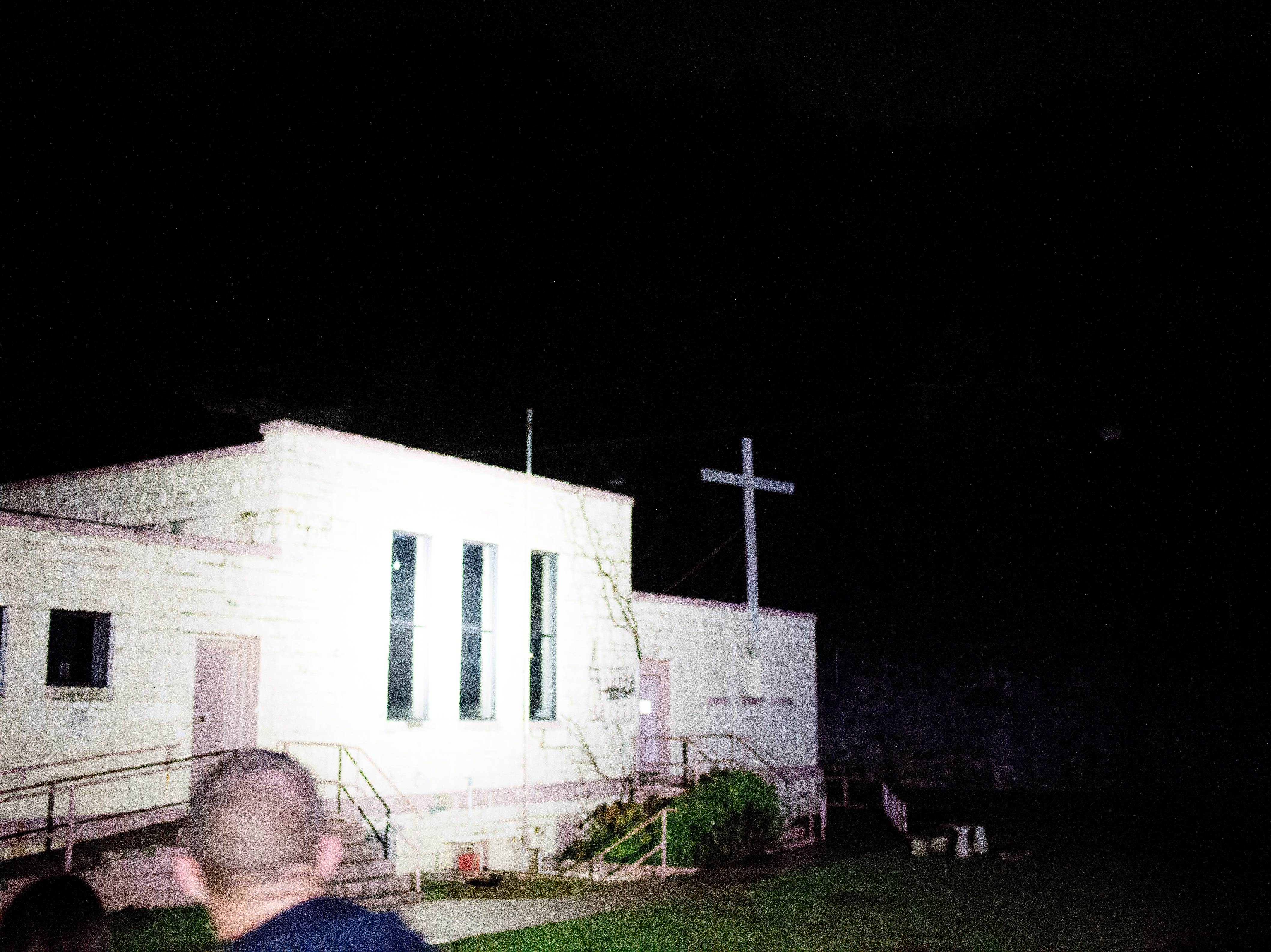 A cross can be seen in front of the chapel during a paranormal flashlight tour of Brushy Mountain State Penitentiary in Petros, Tennessee on Tuesday, October 16, 2018.
