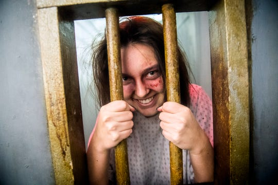 Actor Bailey Skinner plays an insane asylum character at FrightWorks haunted house in Powell.