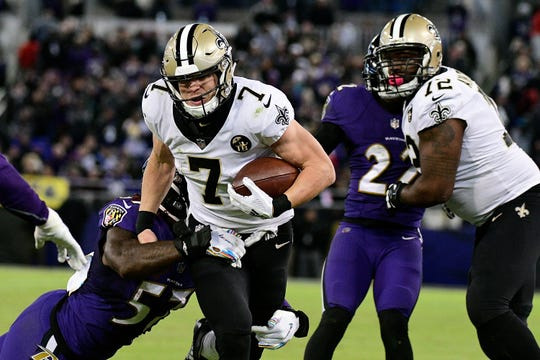 New Orleans Saints quarterback Taysom Hill (7) runs for a first down against the Baltimore Ravens on Sunday at M&T Bank Stadium in Baltimore.