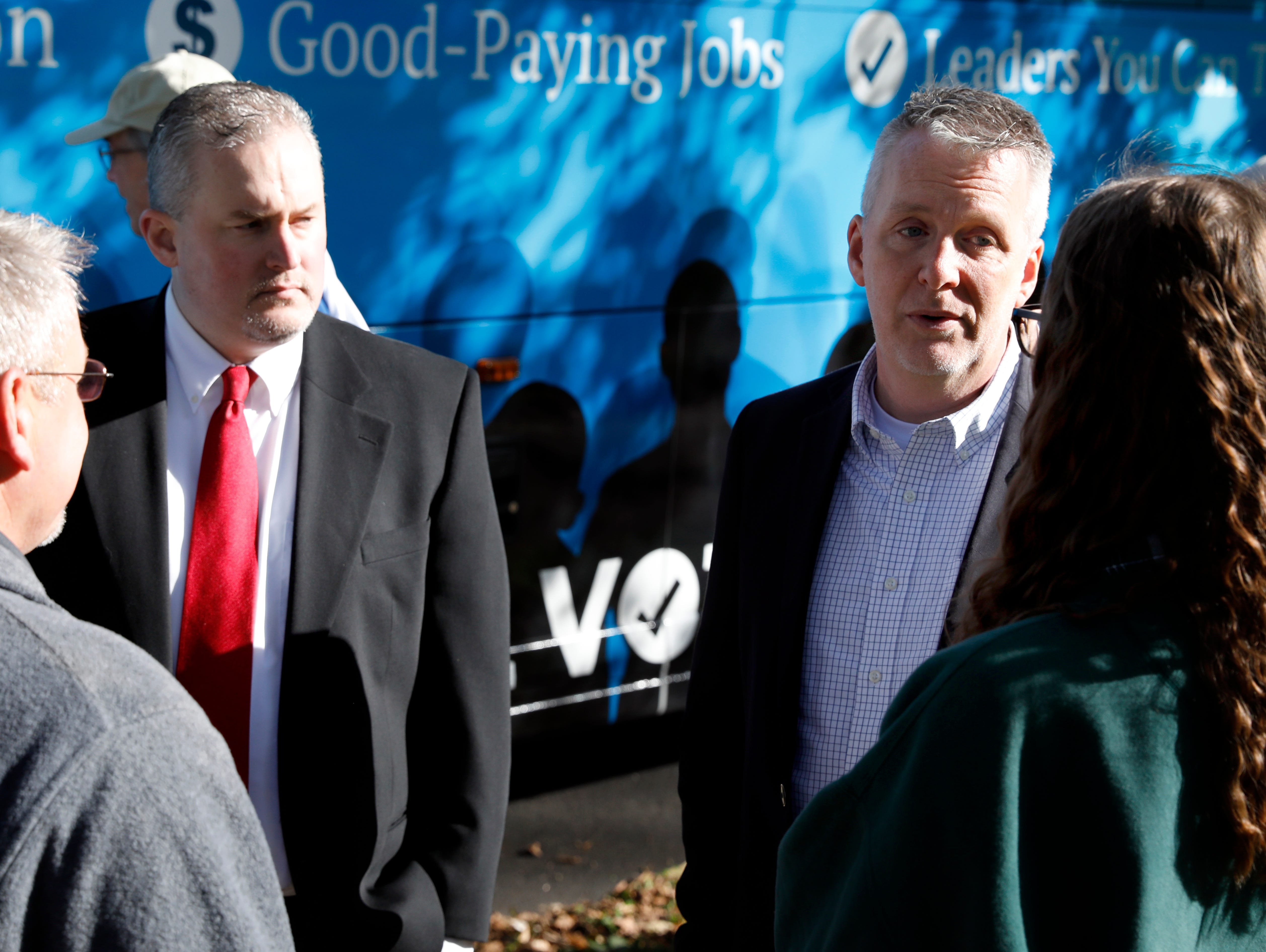 Rick Neal, second from right, and Brett Pransky, second from left, Democratic candidates for the Ohio 15th Congressional district and the Ohio House 77th district speak to Chris Zacker, left, and Haley Zacker Monday morning, Oct. 22, 2018, at Firehouse Park in Lancaster. Neal, Pransky and 78th Ohio House District candidate Amber Daniels were holding a campaign event at the park.
