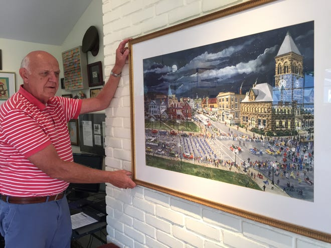 Local artist Ed Kitchen paints scenes of Lancaster Jaycees Mardi Gras. Kitchen, like many other residents, remembers attending the parade as a child.