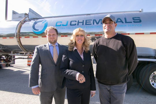 CJ Chemicals is one of the fastest growing woman-owned companies in the country. From left are owners Josh Lee and his mother Cathy Lee, shown with tanker driver Charles Van Vallis Monday, Oct. 22, 2018.