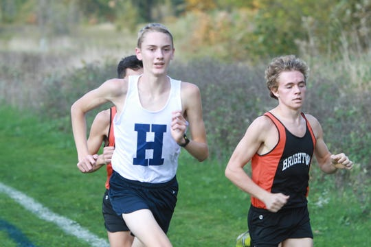 Hartland freshman Riley Hough (left) hopes to crack the top 15 Friday in the regional at Huron Meadows Metropark to qualify for the state cross country meet.