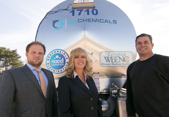 Cathy Lee and her son Josh, left founded chemical distribution and wholesale company CJ Chemicals in Brighton Townshipwith a $4,000 investment, turning it into an $18 million business. Shown with the Lees is driver Charles Van Vallis Monday, Oct. 22, 2018.