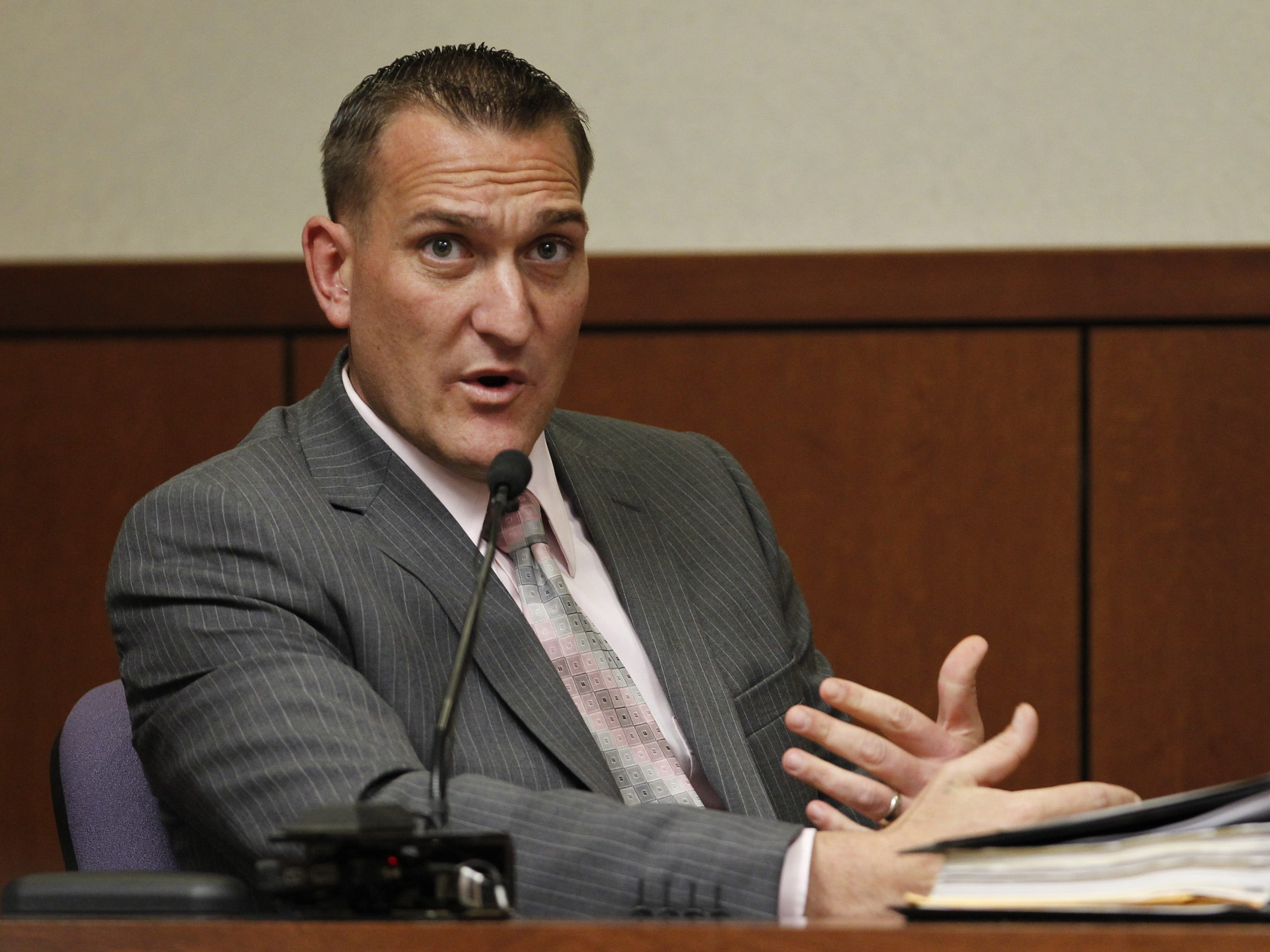 As seen in a 2013, then Louisville Metro Police Detective Jon Lesher addresses the jury during a murder trail at the Jefferson County Judicial Center.