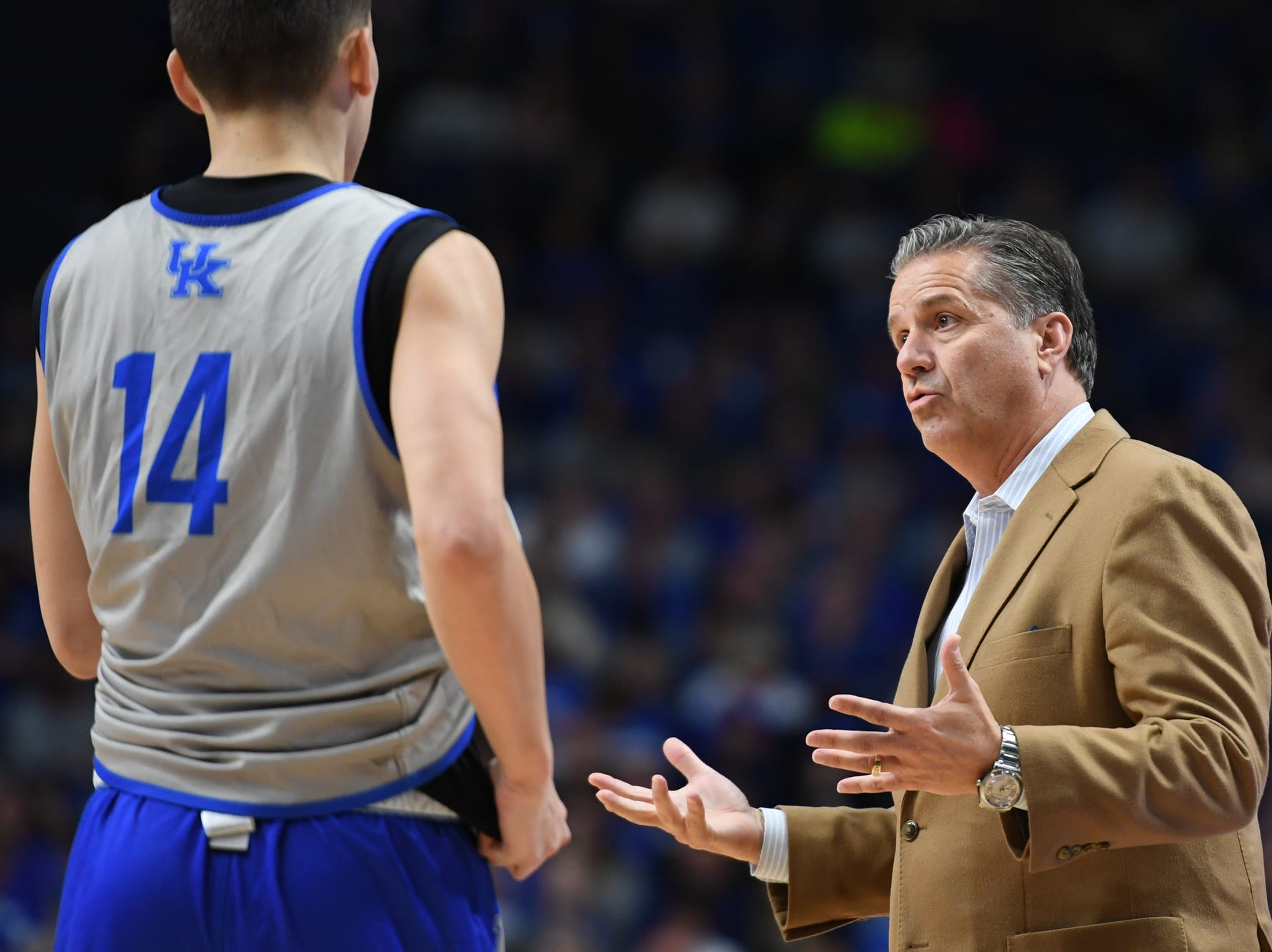 UK head coach John Calipari talks to players on the court during the University of Kentucky mens basketball Blue/White game at Rupp Arena in Lexington, Kentucky on Sunday, October 21, 2018.
