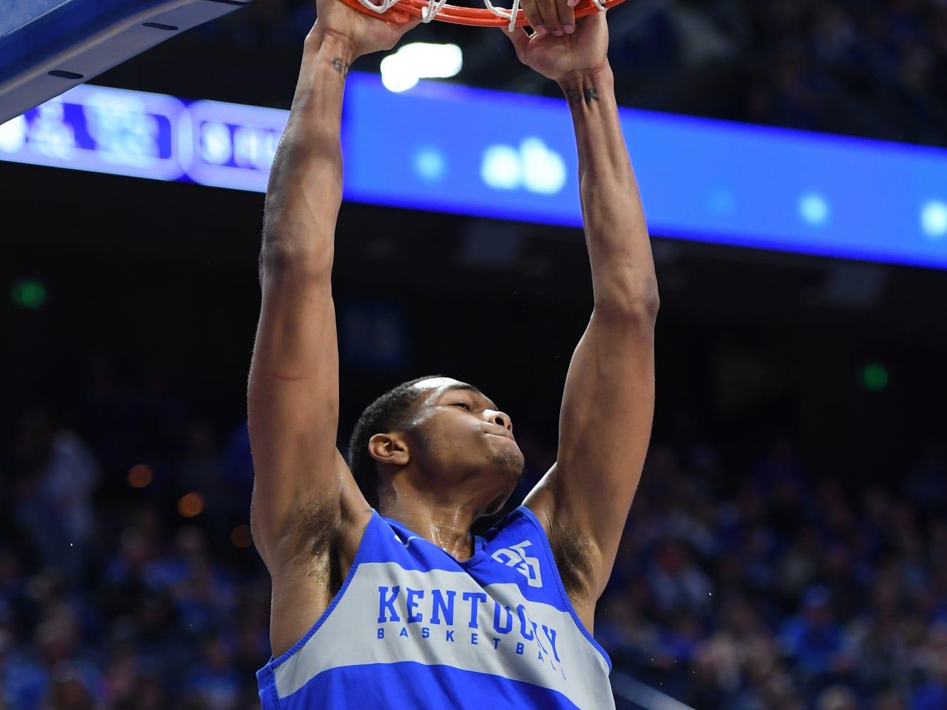 UK F PJ Washington dunks during the University of Kentucky mens basketball Blue/White game at Rupp Arena in Lexington, Kentucky on Sunday, October 21, 2018.