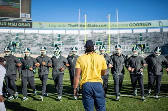 Devin Bush and Michigan State's football team collide at midfield at Spartan Stadium before Saturday's game.