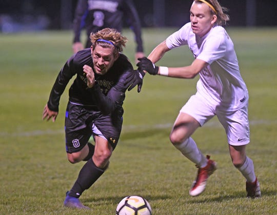 Ontario's Brennan Blaising races Isaac Lindo of Vermilion to the ball Monday night during the Division II District Soccer Tournament in Lexington.