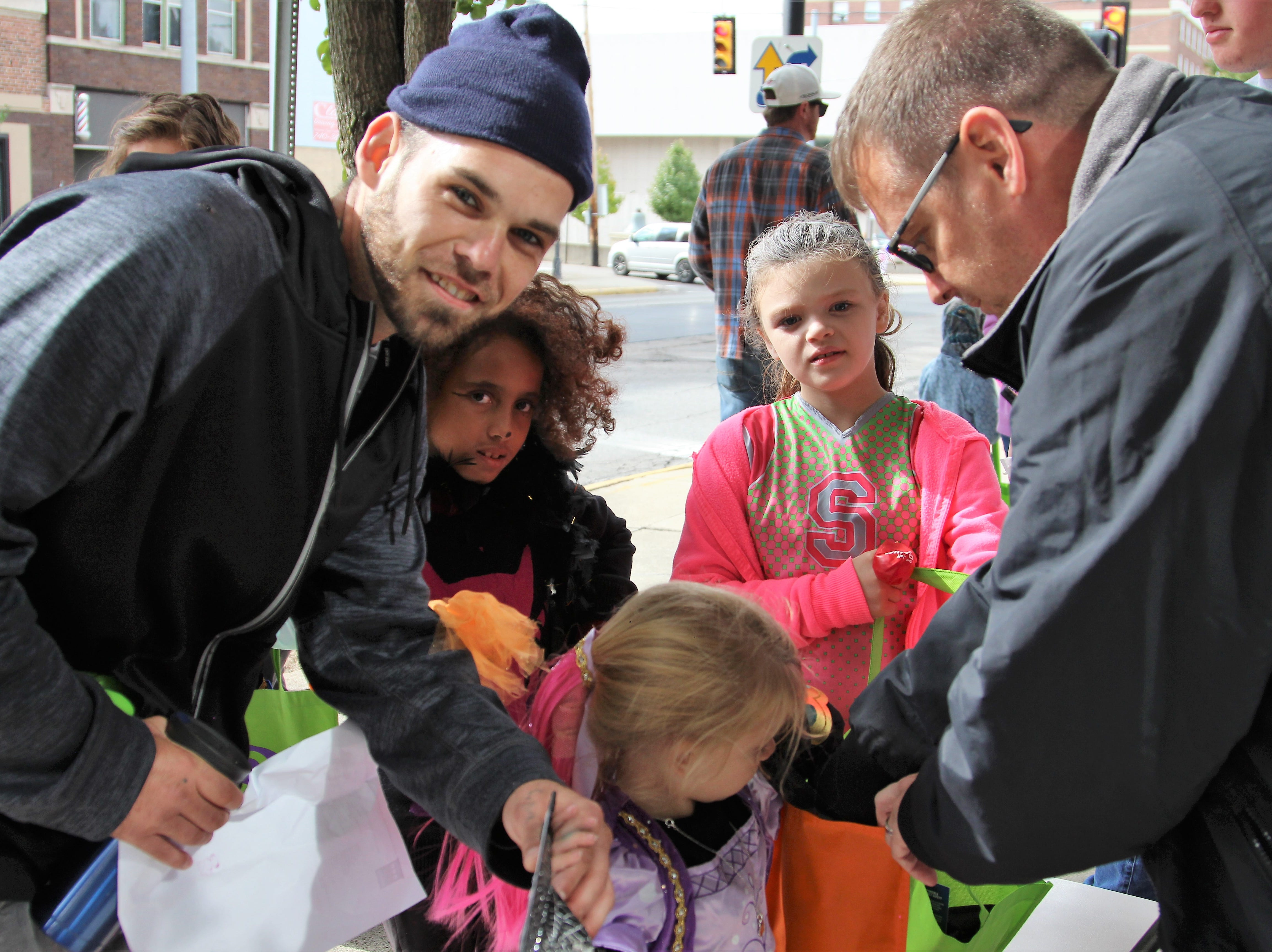 Marion residents walked around the city's downtown area on Saturday for early trick or treating.